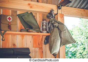 Retro survival kit in a wooden cabin in the nature
