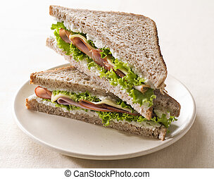 Sandwich - Fresh toast sandwich with ham and cheese close up...