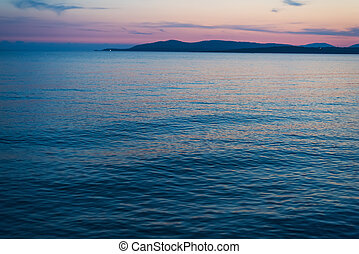 pink sky over Capo Caccia at sunset, Sardinia
