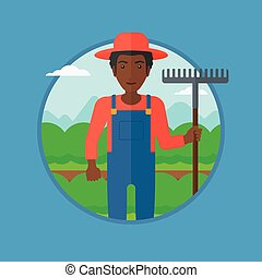 Farmer with rake at cabbage field. - An african-american...