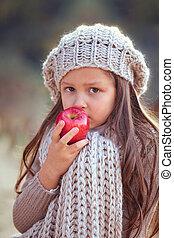 Beautiful girl eating apple - Beautiful girl in autumn...