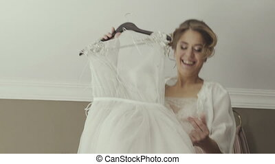 bride jumping on the bed in the rich interior