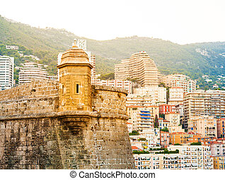 Detail of Prince's Palace in Monaco-ville and the city in...
