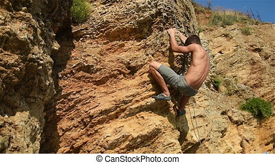 Climber Hanging On Cliff - Muscular Climber Hanging On The...