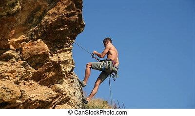 Climber Man Descends A Rope - Rock Climber Descends A Rope...