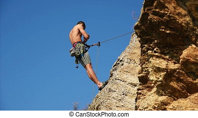 Climber Man Hanging On Cliff - Climber Hanging On The Rock...