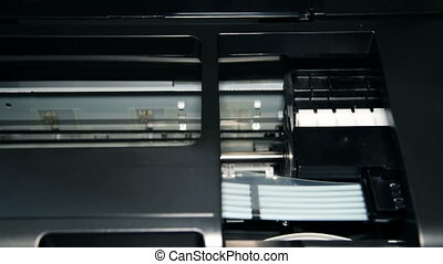 Continuous Ink Feed Printer Printing Photo. Close Up.