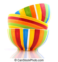 colorful stripes in stacked bowls isolated over white