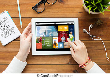 close up of woman with tablet pc on wooden table - business,...