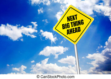 Next big thing ahead message on road sign over the blue sky