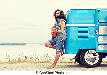hippie man playing guitar over minivan on beach - nature,...