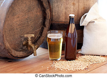 close up of beer barrel, glass, bottle and malt - brewery,...