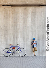 man with smartphone, earphones and bicycle - people,...