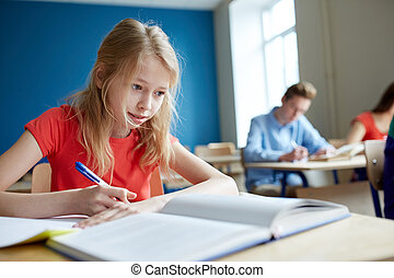 student girl with book writing school test - education,...
