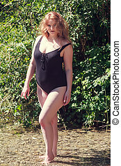 Refreshing Swim in the Lake - Model with oversize stands in...