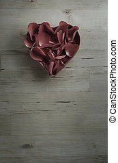 Plum Toned Rose Petals in Heart Shaped Bowl on Wood -...