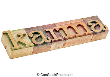 karma word in wood type - karma word - isolated text in...
