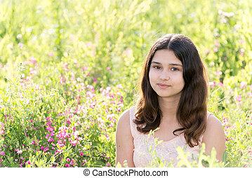 Modest well-groomed girl on summer flower meadow - Modest...