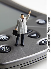 Technology for small business - Businessman figurine...