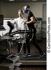 He must be in a good shape - Shot of an athlete wearing an...
