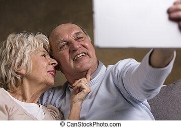 Elderly people taking selfie - Senior citizens taking selfie...