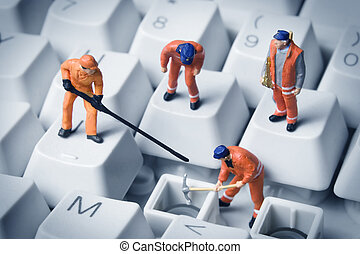 Building a small tech business - Worker figurines posed to...