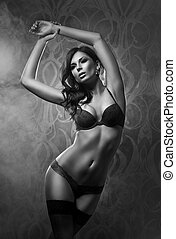 Young and sexy woman in erotic lingerie - Grayscale photo of...