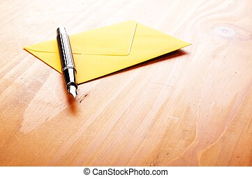 mail or email concept with envelope and pen