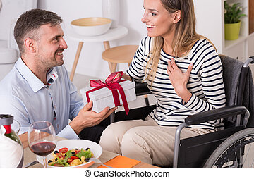 For my beloved wife... - Happy husband giving a gift to his...