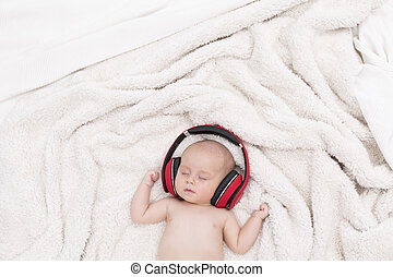 Born in technological age - Newborn baby with the red...