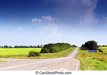 Russian road landscape On the road sign specified distance...