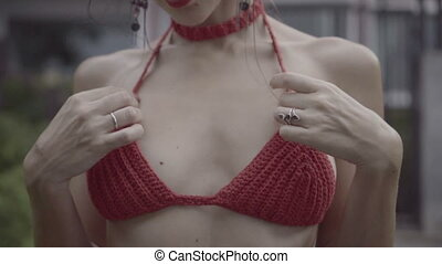 Beautiful brunette woman in crochet bikini - Closeup chest...