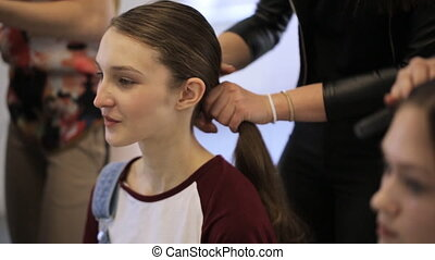 In model schools young female is waiting for hair done....
