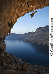 Male rock climber on overhanging cliff, Kalymnos Island,...