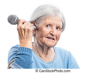 Elderly woman holding microphone