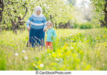 Grandma supported by great grandson