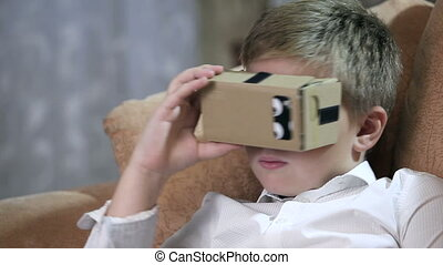 Boy wearing virtual reality goggles HD. - Boy wearing...