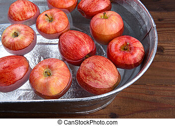 Apple Bobbing Tub - A metal tub filled with water and apples...