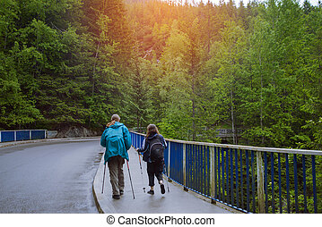 Woman walking over wooden bridge