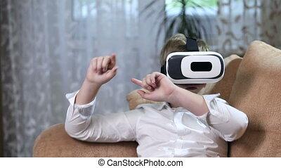 Boy wearing virtual reality goggles HD. - Boy wearing...