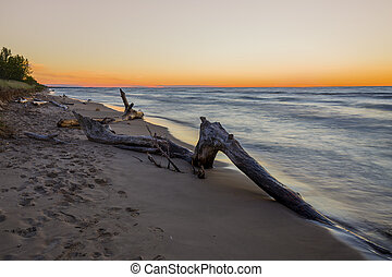 Driftwood on a Lake Huron Beach after Sunset - Canada -...