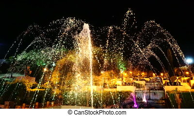 Drops of fountain at night. - Illuminated drops of fountain...