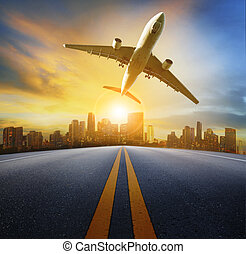 road perspective to town and passenger plane flying...
