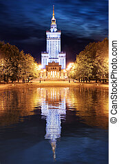 Palace of Culture and Science in Warsaw, Poland at night.