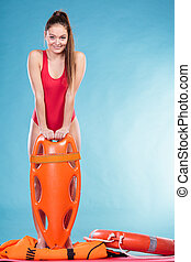 Lifeguard on duty with rescue buoy supervising. - Lifeguard...