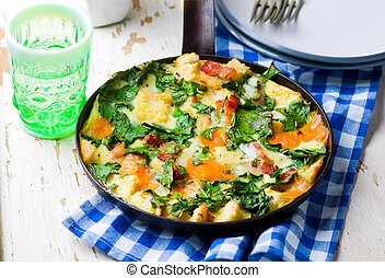 Skillet Strata with Bacon, Cheddar, and Greens . selective...