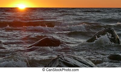 Seaside sunset on Baltic sea - Seaside sunset on wavy Baltic...