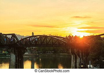 Sunset at the bridge over the river kwei - KANCHANABURI,...