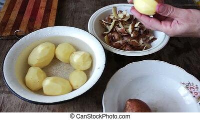 women's hands clean potatoes peeled - women's hands clean...