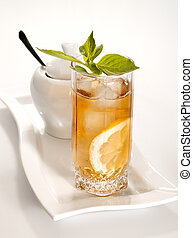 glass of cold green tea with ice, mint and lemon on the...